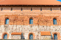 Brick castle wall with windows