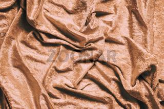 gold or copper colored velvet background