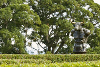 Labyrinth maze of Holly hedges in the Walled Garden of Cawdor Castle with bronze minotaur sculpture.