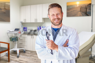 Caucasian Male Doctor Standing In Office
