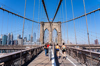 People on Brooklyn Bridge in New York City