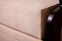 Close-up handle armrest textile beige sofa. New furniture. Shallow depth of field