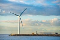 Windmill at edge of breakwater