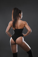 A beautiful sports brunette, back and buttocks