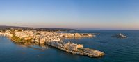 Aerial sunrise view of Vieste town and Church of San Francesco, Italy