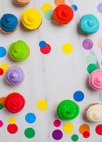 Colourfull cupcakes flat lay with vivid circles