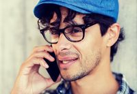 close up of man calling on smartphone