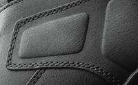 leather boots stitched with thread close up