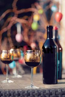 Bottle of vine, glass and easter eggs