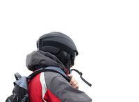 Skier in helmet and ski mask on white background