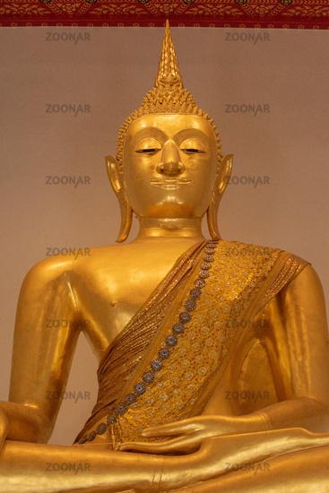 Close-up of golden Buddha in meditative pose