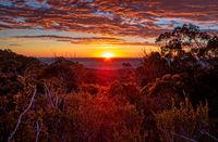 Glorious sunrise views to horizon across mountain ranges