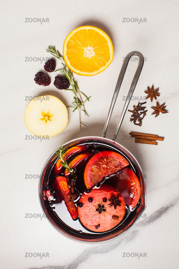 Mulled wine hot drink with citrus, apple and spices