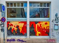 Traffic signs and windows with graffiti