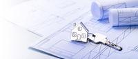Keys with house as keyring on blueprints