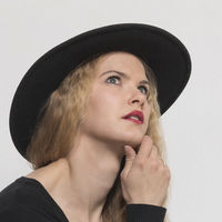 Woman portrait with black hat in front of white background