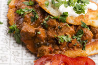 Potato pancakes with meat, vegetable, tomato and parsley