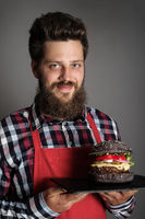 Cook with black burger