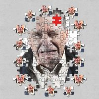 Jigsaw concept of mental illness or dementia with senior caucasian man weeping and alone
