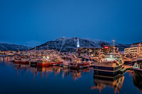 Tromso harbour in winter at night