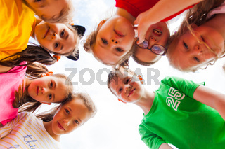 Close portrait of group of kids faces in circle