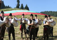 Rhodope bagpipers playing tunes on a famous Rozhen folklore festival in Bulgaria