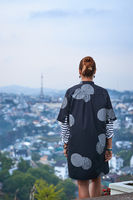 Woman overlooking the city view, Dalat, Vietnam