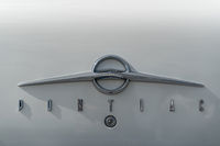 The emblem on the trunk lid car of Pontiac. Close-up.