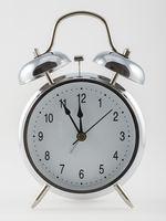 Vintage alarm clock isolated on white background.