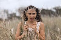 Beautiful carefree woman romantic portrait in fields happy outdoors