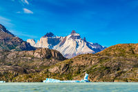 Beautiful landscape with Iceberg floating in the lake grey infront of the beautiful mountain