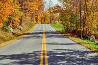 Highway at autumn day, Vermont, USA.
