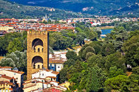 Florence tower of San Niccolo and Arno river green waterfront view
