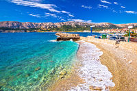 Baska. Idyllic pebble beach and town of Baska view