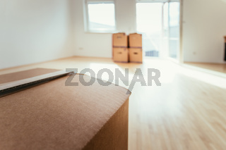 Move. Cardboard, boxes for moving into a new, clean and bright home