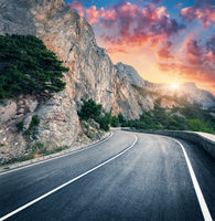 Mountain road and beautiful sky at sunset. Colorful landscape