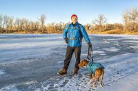 winter hiker with pitbull dog