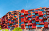 Newly built red multi-family apartment house seen in Berlin, Germany