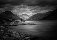 Moody black and white image of Wast water in english lake district