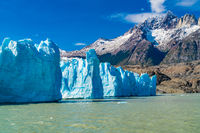 View of blue Iceberg of Grey Glacier in Grey Lake and beautiful snowy mountain