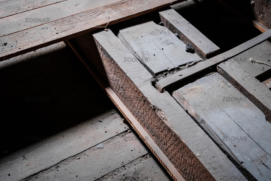 construction detail, metal and wood beam closeup in  attic / loft -