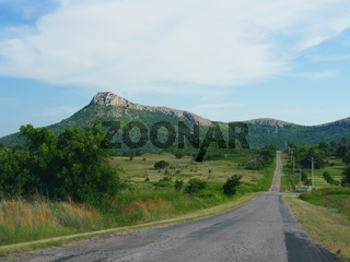 Scenic drive with the Wichita Mountains in the background, Oklahoma.