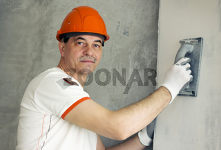 Specialist aligns the wall in the room