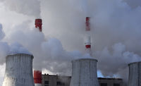 smoking chimneys of power plant in strong steam