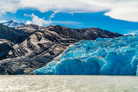 View of the beautiful Blue Iceberg of Glacier Grey on Lake Grey with Rock mountain