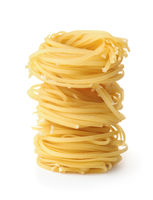 Stack of uncooked tagliolini pasta nest