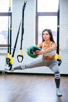 Young adult girl doing exercises in the gym