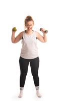 Funny fat girl with dumbbell isolated shot