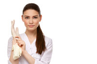 woman doctor in rubber gloves isolated on white