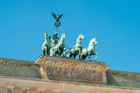 Top of  Brandenburger Tor - Berlin landmark isoalted on blue sky